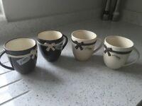 Next mugs x4