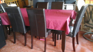Dining room table with 7 high back leather chairs