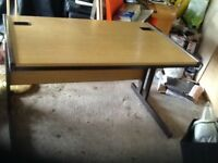 A teak top office desk with a metal base