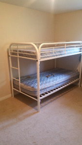 Twin over twin white metal bunk beds