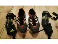 For sale are pair of the Adidas football boots and shin guards.