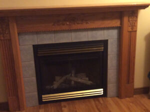 Napoleon propane fireplace with the mantle and surround