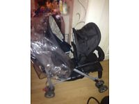 Double pram with rain cover
