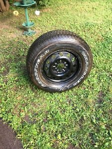New Goodyear wrangler tire on rim for sale