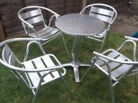 Set of four metal chairs and table for garden