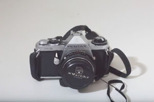 Pentax ME w/50mm f/1.7 film camera, and case.