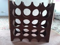 Handmade bottle rack suitable for most sized bottles.