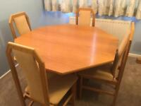 Light oak extendable table & 4 light oak chairs