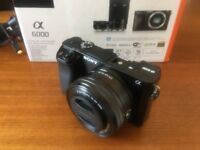 Sony A6000 with 16-50mm lens, charger and spare batteries, memory card