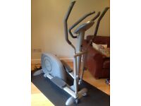 Tunturi elliptical cross trainer with base mat
