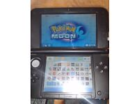 Black/Blue 3DSXL With 32GB Memory Card and Over 40 3DS Games installed.