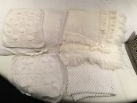 Bundle of knitted baby blankets