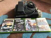 Xbox 360 with hard drive and game shown