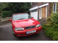 1997 Volvo S70 2.5T Auto, red with tan leather interior. Good condition, documented mileage
