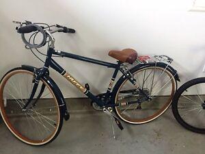 Two mens/boys bikes