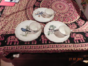 Three beautiful cups with saucers.