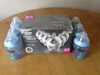 Tommy Tippee Closer to Nature 12 Medium Size Bottles + 2 Black Bottle Warmers Bags.