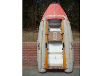 Tinker Tramp inflatable dinghy with oars and liferaft conversion kit.