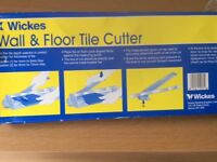 Tile Cutter and wood plane for sale. Sell both for £10. need to collect.