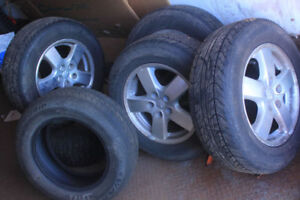Set of 4 Uniroyal Tigerpaw Tires + a spare