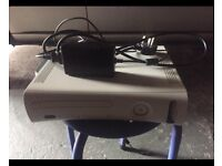 Xbox 360 with power cable. No controllers or games.
