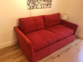 Two and a half seat, double sofa bed in chili brushed linen cotton.