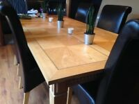 Large Solid Light Laquer Finish Oak Dining Table + 6 Dark Brown Faux Leather Chairs