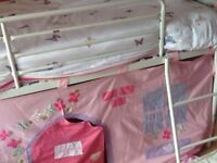 Next white metal mid sleeper bed with pink girls tent.