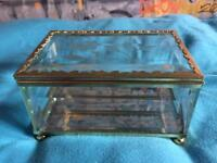 Glass jewellery box with gold trim and mirror bottom