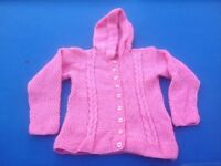 Child's pink knitted hooded cardigan