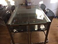 Glass/Chrome Plated Dining Table and Black/Chrome Chairs
