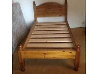 Single (3 foot) pine bed with mattress.