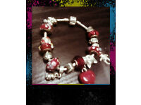 Pandora charm bracelet with murano glass charms amongst other silver charms