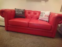 Red leather sofa bed.