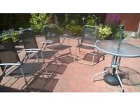 Frosted Garden table and matching foldable chairs