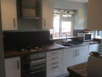 Complete fitted kitchen gloss white units sink taps oven gas hob work tops