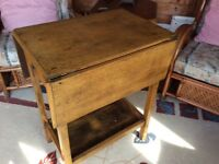 Small 1940 table small draw at front can be used as a drop leaf table as well and a bottom shelve