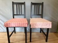 2 x Ikea wooden 'Stefan' chairs in brown/black with pink Ikea 'Elsebet' cushions