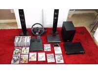 Playstation 3 slim 500 Gb PLus Logitech steering wheel & pedals & loads of games