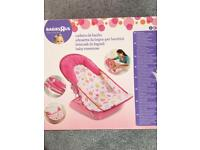 Baby bath seat and tummy time toy