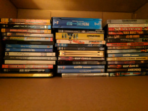 Box of assorted DVDs and BluRays