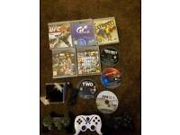 PlayStation 3 Slim 320GB WITH 3 CONTROLLERS AND 9 GAMES