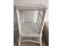 White wicker bed side table.