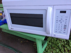 2 year old LG OC Microwave Oven (white)