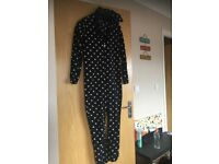 BLACK AND WHITE POLKADOT ONESIE WITH DRAWSTRING HOODIE AND ZIP