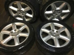 Set of 4 245 45 18 tires with 4 Nissan rims 18 inches