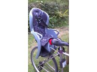 Childrens rear bike seat with lockable bracket. Halfords Hamax branded seat in good condition.