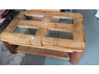 Mexican pine coffee table with glass panels, very heavy and solid construction good condition £60
