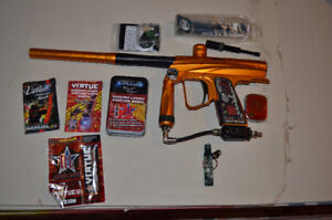 various paintball markers and gear