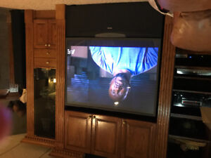 Solid oak with 62inch Hd Toshiba television